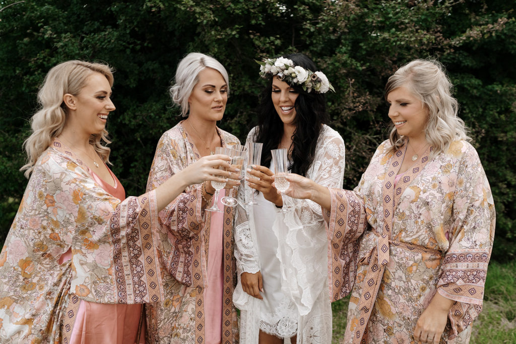 Bridesmaids toasting their bride